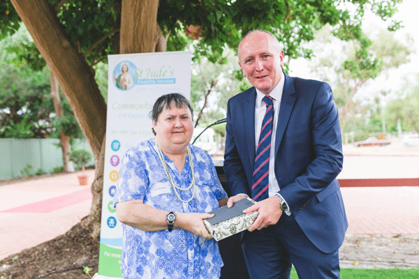 minister for health gives patient a gift